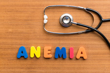 anemia colorful word on the wooden background