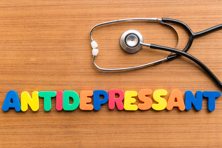 antidepressant: antidepressant colorful word on the wooden background Stock Photo