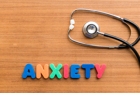 anxiety colorful word on the wooden background