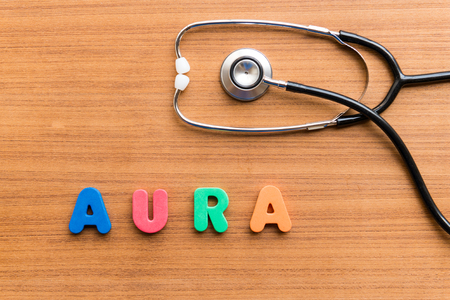 aura: aura colorful word on the wooden background Stock Photo