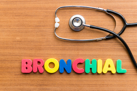 bronchial: BRONCHIAL colorful word on the wooden background Stock Photo