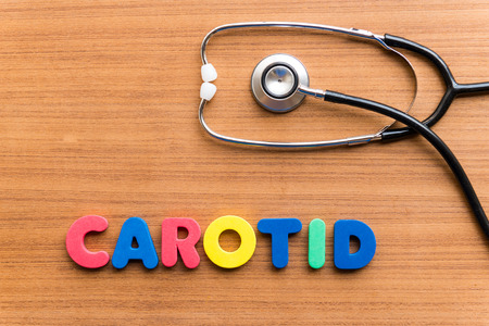 carotid: CAROTID colorful word on the wooden background Stock Photo