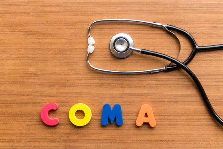 coma: COMA colorful word on the wooden background