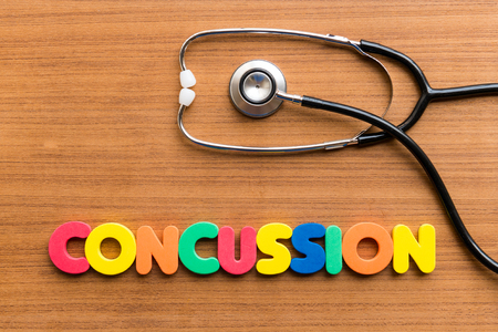 concussion: CONCUSSION colorful word on the wooden background