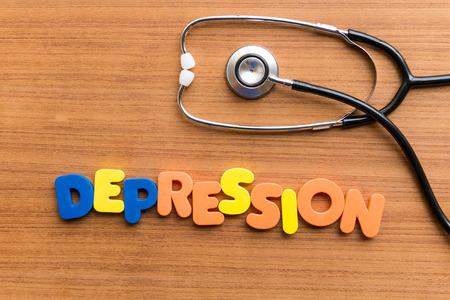 DEPRESSION buntes Wort auf dem hölzernen Hintergrund Standard-Bild - 38373104