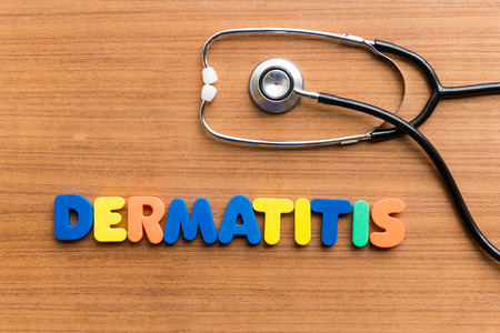 DERMATITIS colorful word on the wooden background Stock Photo - 38373110