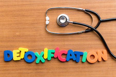 detoxification: DETOXIFICATION colorful word on the wooden background Stock Photo