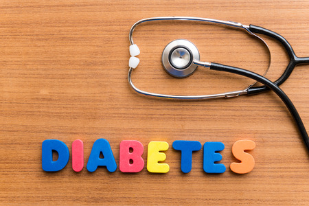 DIABETES colorful word on the wooden background Standard-Bild