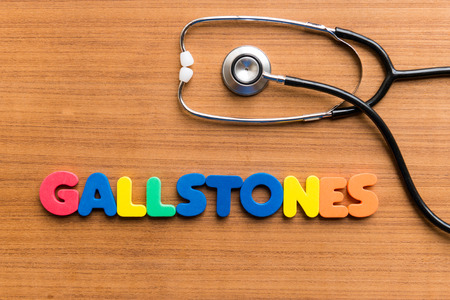 gallstones: gallstones colorful word on the wooden background