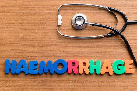 haemorrhage: haemorrhage colorful word on the wooden background