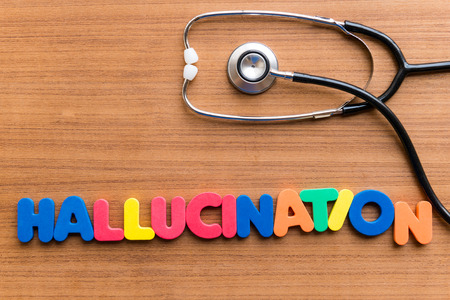hallucination: hallucination colorful word on the wooden background Stock Photo
