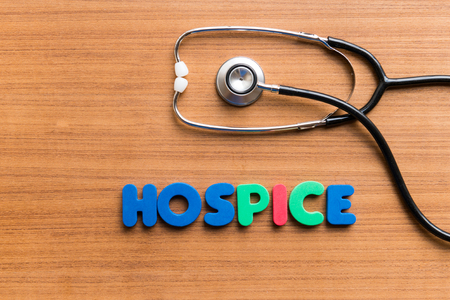 horrified: hospice colorful word on the wooden background Stock Photo