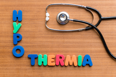 problem health: hypothermia colorful word on the wooden background