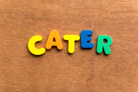 cater: cater colorful word on the wooden background Stock Photo
