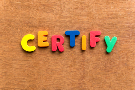 certify: certify colorful word on the wooden background Stock Photo