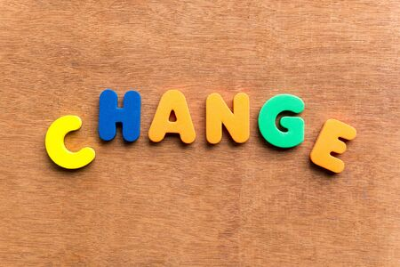 modulate: change colorful word on the wooden background Stock Photo