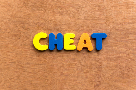 cheat: cheat colorful word on the wooden background