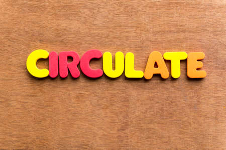 circulate: circulate colorful word on the wooden background Stock Photo