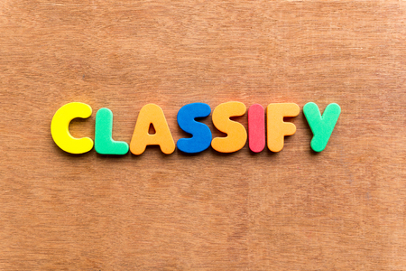 classify: classify colorful word on the wooden background