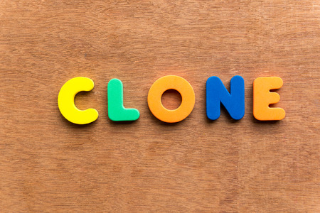 clone: clone colorful word on the wooden background Stock Photo