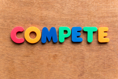 contend: compete colorful word on the wooden background