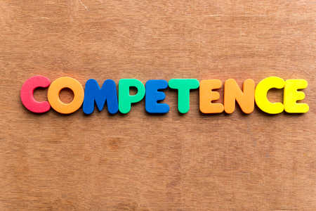 competence: competence colorful word on the wooden background