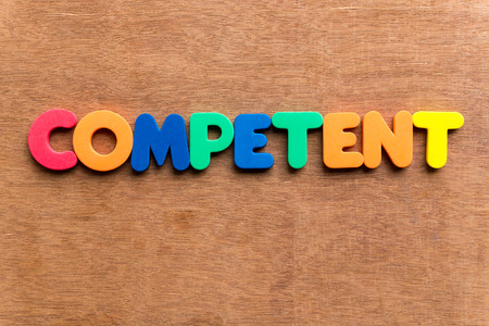 competent colorful word on the wooden background