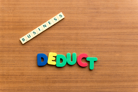 deduct: deduct colorful word on the wooden background