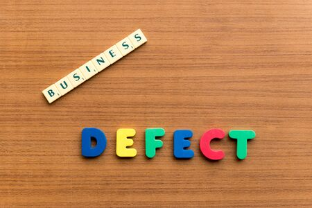 imperfection: defect colorful word on the wooden background Stock Photo