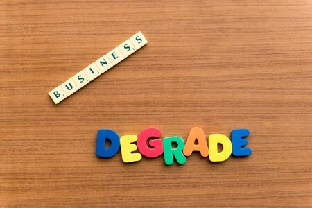 degrade: degrade colorful word on the wooden background