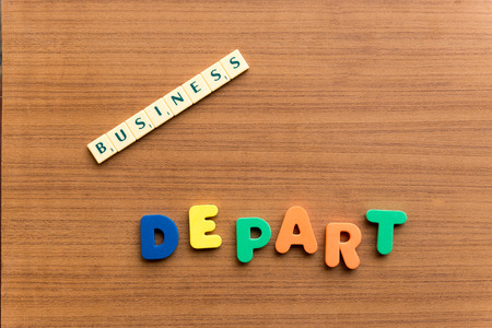 depart: depart colorful word on the wooden background