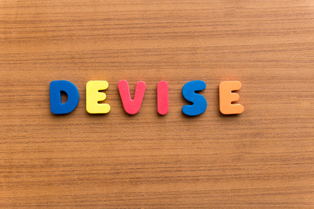 devise: devise colorful word on the wooden background