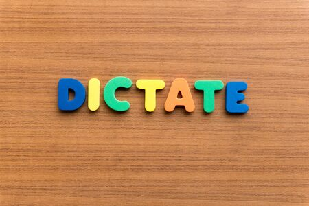 dictate: dictate colorful word on the wooden background
