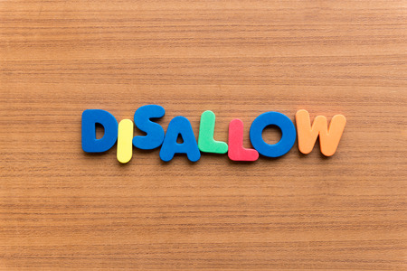 disallow: disallow colorful word on the wooden background