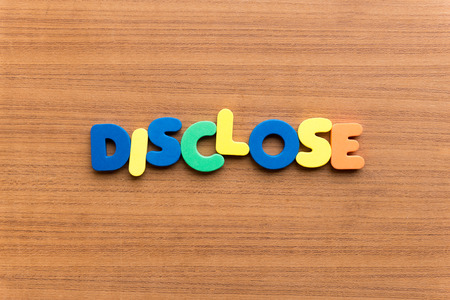 disclose: disclose colorful word on the wooden background