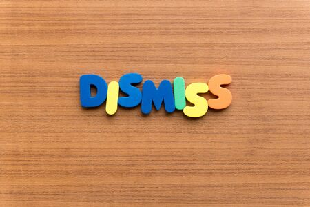 dismiss: dismiss colorful word on the wooden background