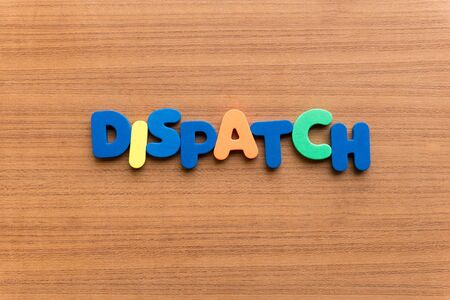 dispatch: dispatch colorful word on the wooden background