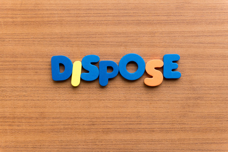 dispose: dispose colorful word on the wooden background