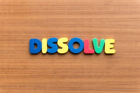 dissolve: dissolve colorful word on the wooden background