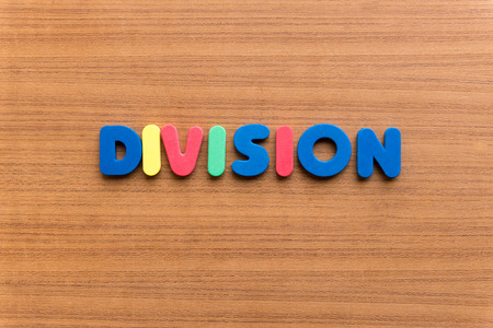 division: division colorful word on the wooden background