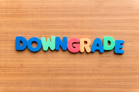 downgrade: downgrade colorful word on the wooden background
