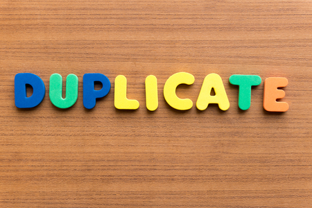 duplicate: duplicate colorful word on the wooden background