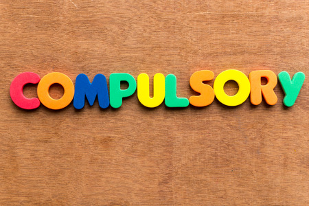 incumbent: compulsory colorful word on the wooden background Stock Photo