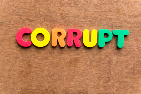 pervert: corrupt colorful word on the wooden background Stock Photo