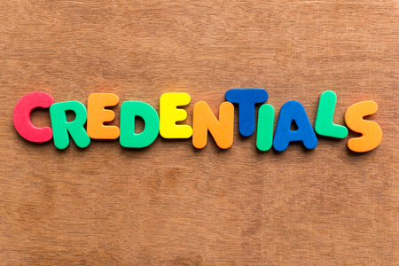 credentials: credentials colorful word on the wooden background Stock Photo