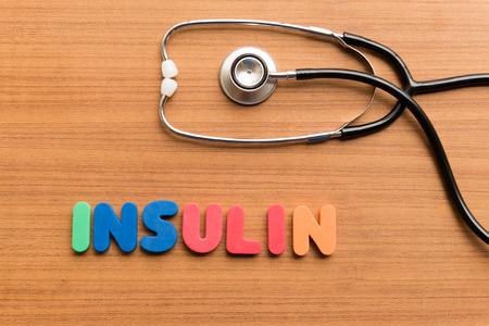 Insulin bunten Wort auf dem hölzernen Hintergrund Standard-Bild - 38866840