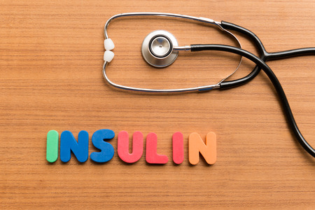 medium group of objects: insulin colorful word on the wooden background