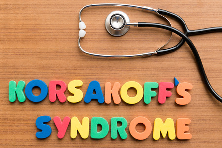 medium group of objects: korsakoffs syndrome colorful word on the wooden background
