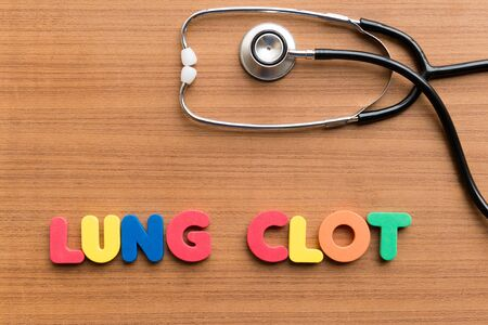 clot: lung clot colorful word on the wooden background Stock Photo