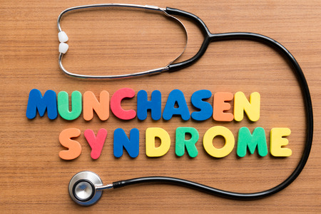 munchasen syndrome colorful word on the wooden background